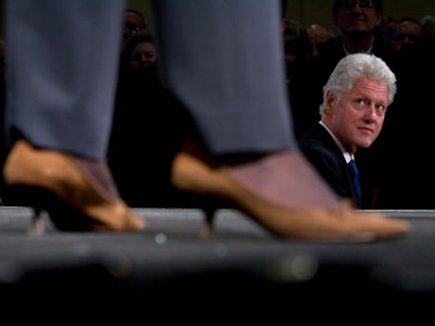 President Bill Clinton listens to his wife Senator Hillary Rodham Clinton on the campaign trail.