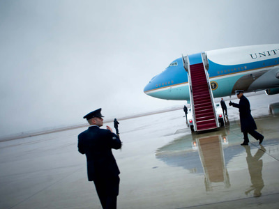 Members of the Air Force direct stairs back from Air Force One.