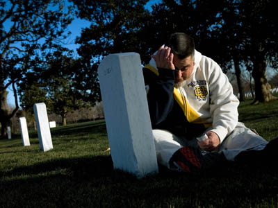 Darrell Blackwell visits the grave of his sister at Arlington National Cemetery.